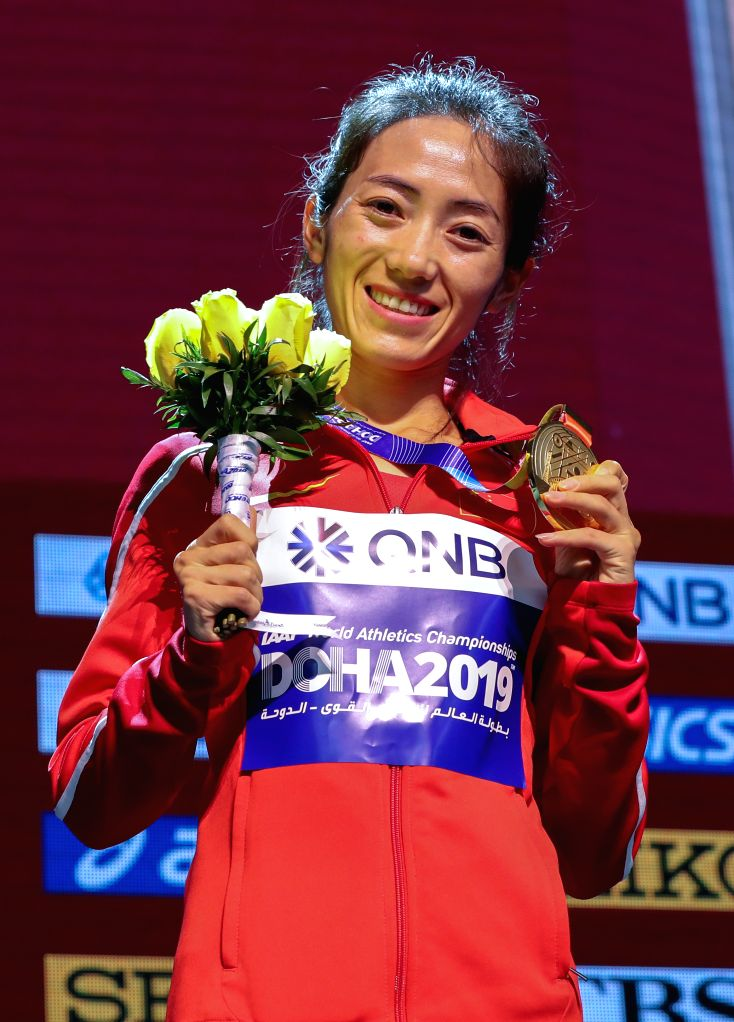 DOHA, Sept. 29, 2019 - Gold medalist Liang Rui of China poses for pictures at the awarding ceremony of women's 50km race walk during the 2019 IAAF World Athletics Championships in Doha, Qatar, on ...