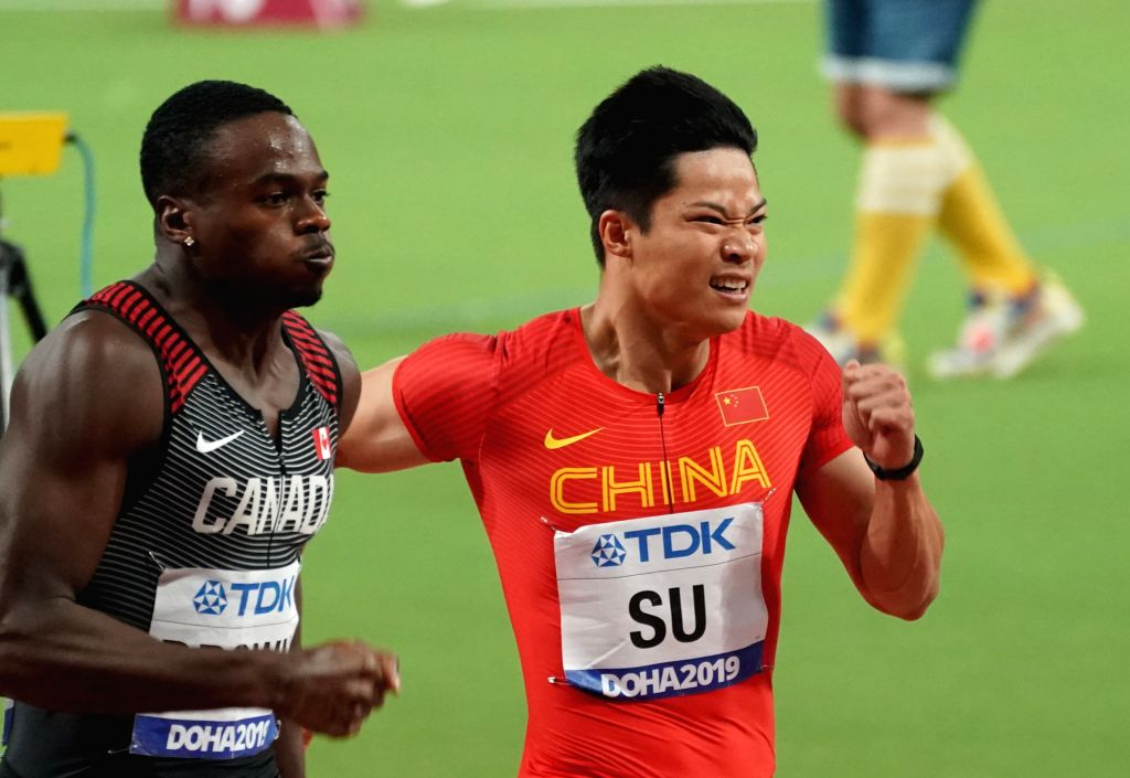 DOHA, Sept. 29, 2019 - Su Bingtian (R) of China competes during the men's 100m semifinal at the 2019 IAAF World Athletics Championships in Doha, Qatar, Sept. 28, 2019.