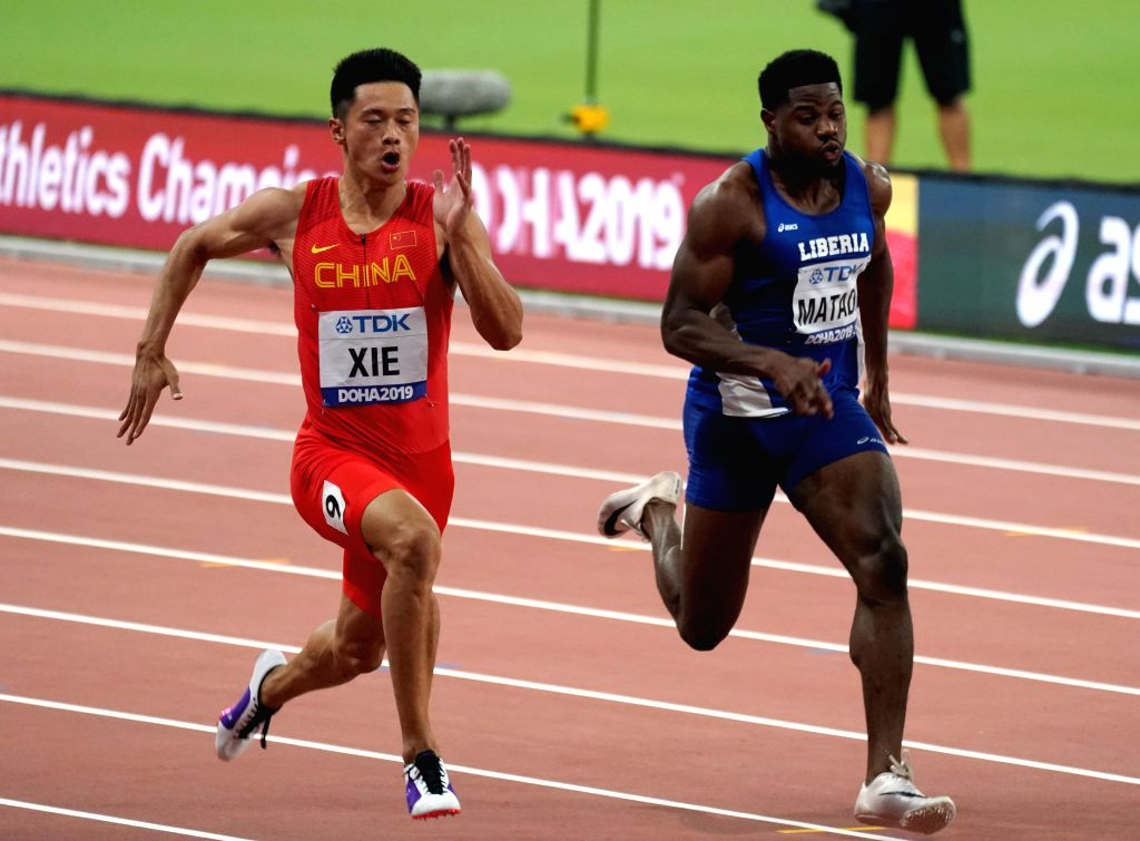 DOHA, Sept. 29, 2019 - Xie Zhenye (L) of China competes during the men's 100m semifinal at the 2019 IAAF World Athletics Championships in Doha, Qatar, Sept. 28, 2019.