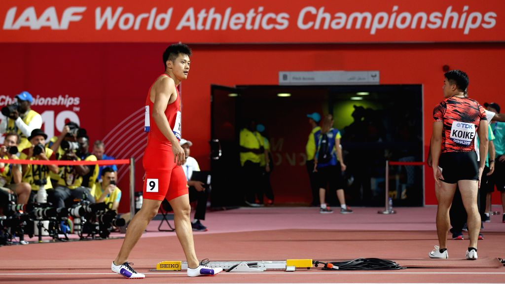 DOHA, Sept. 29, 2019 - Xie Zhenye (L) of China leaves the track after the men's 100m semifinal at the 2019 IAAF World Athletics Championships in Doha, Qatar, Sept. 28, 2019.