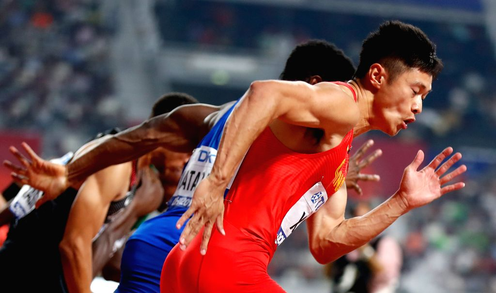 DOHA, Sept. 29, 2019 - Xie Zhenye of China (front) competes during the men's 100m semifinal at the 2019 IAAF World Athletics Championships in Doha, Qatar, Sept. 28, 2019.