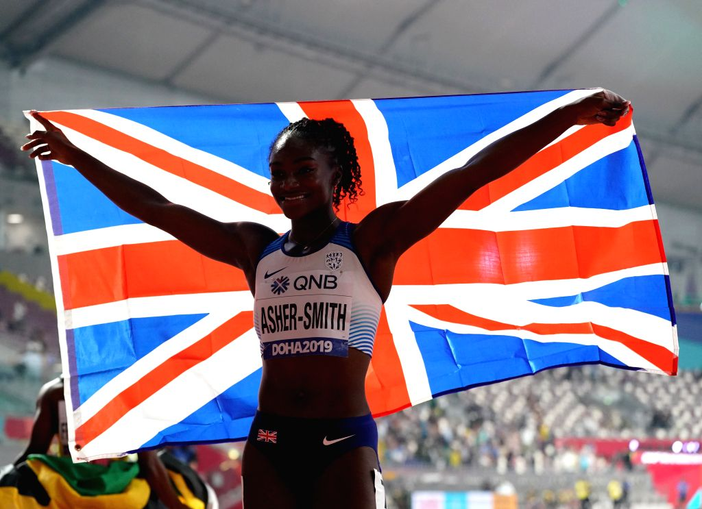 DOHA, Sept. 30, 2019 (Xinhua) -- Dina Asher-Smith of Britain celebrates after the Women's 100 Meters Final at the 2019 IAAF World Championships in Doha, Qatar, Sept. 29, 2019. (Xinhua/Li Gang/IANS)