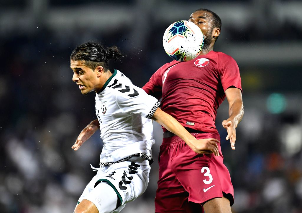 DOHA, Sept. 6, 2019 - Abdulkarim Hassan (R) of Qatar vies with Milad Intezar of Afghanistan during the FIFA World Cup Qatar 2022 and AFC Asian Cup China 2023 Preliminary Joint Qualification second ... - Abdulkarim Hassan