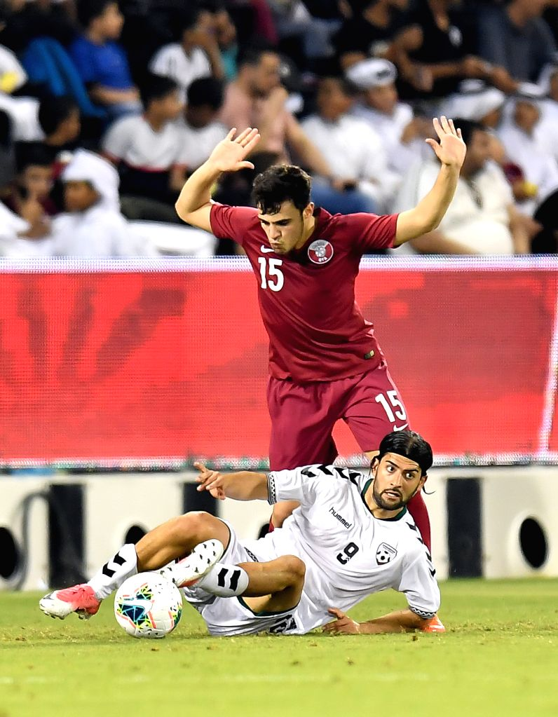 DOHA, Sept. 6, 2019 - Jabar Sharza (bottom) of Afghanistan vies with Bassan Alrawi of Qatar during the FIFA World Cup Qatar 2022 and AFC Asian Cup China 2023 Preliminary Joint Qualification second ...