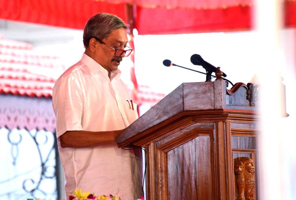 Dona Paula: BJP leader Manohar Parrikar swears-in as the new Chief Minister of Goa during his swearing in ceremony at Raj Bhavan in Dona Paula on March 14, 2017.