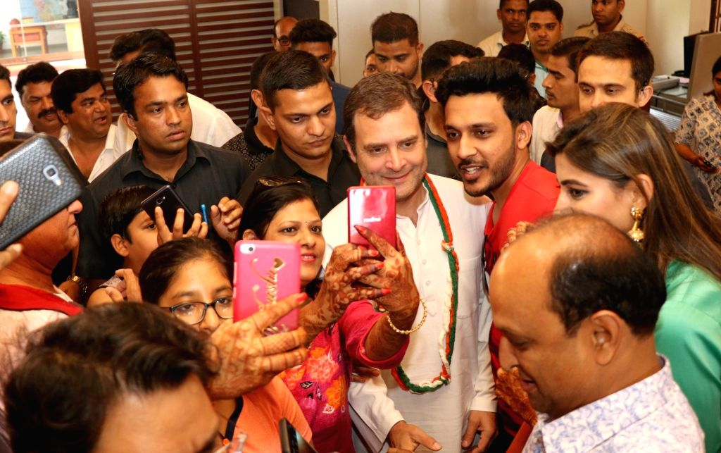 Dona Paula (Goa): Tourists click selfie -self portrait - with Congress President Rahul Gandhi at a hotel in Dona Paula, Goa on March 9, 20199. Gandhi was at the hotel to meet the dependents of people ... - Rahul Gandhi