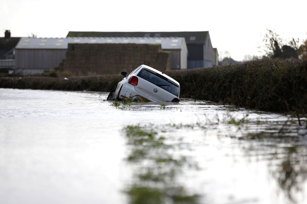 DONCASTER, Nov. 12, 2019 - Photo taken on Nov. 11, 2019 shows a car in floodwater on the road leading to Fishlake village in Doncaster, Britain. The British government activated on Saturday an ...
