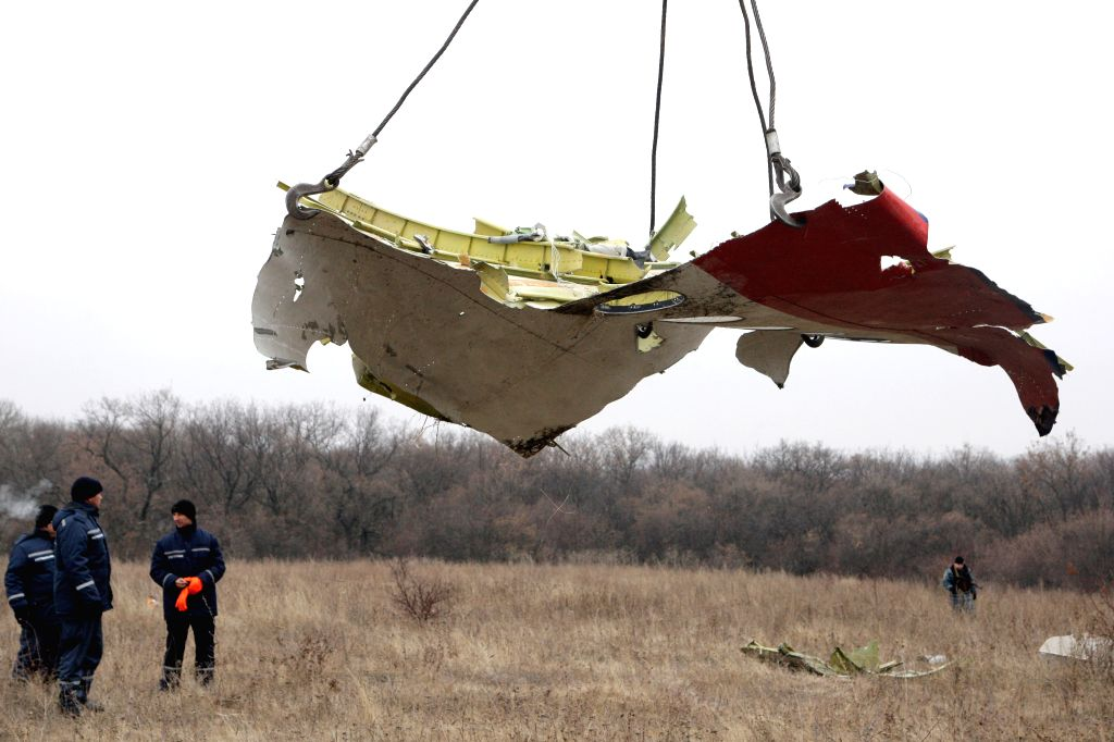 Donetsk (Ukraine) Workers work on the site where the MH17 plane of Malaysia Airlines crashed, on the outskirts of Donetsk, eastern Ukraine, on Nov. 18, 2014. The recovery of the wreckage of flight MH17 will be completed in around five days, the Dutch