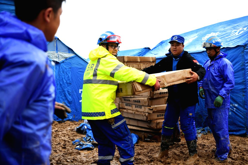 DONGXIANG, July 20, 2018 - Rescuers convey disaster relief materials at flood-hit Chenhe Village of Dongxiang Autonomous County in Linxia Hui Autonomous Prefecture, northwest China's Gansu Province, ...