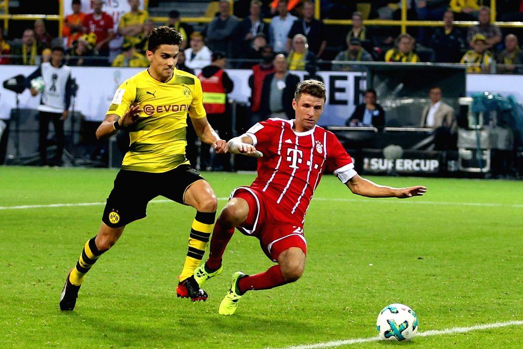 DORTMUND, Aug. 6, 2017 - Bayern Munich's Thomas Mueller (R) vies with Dortmund's Marc Bartra during the 2017 German Super Cup match between Bayern Munich and Borussia Dortmund in Dortmund, Germany, ...