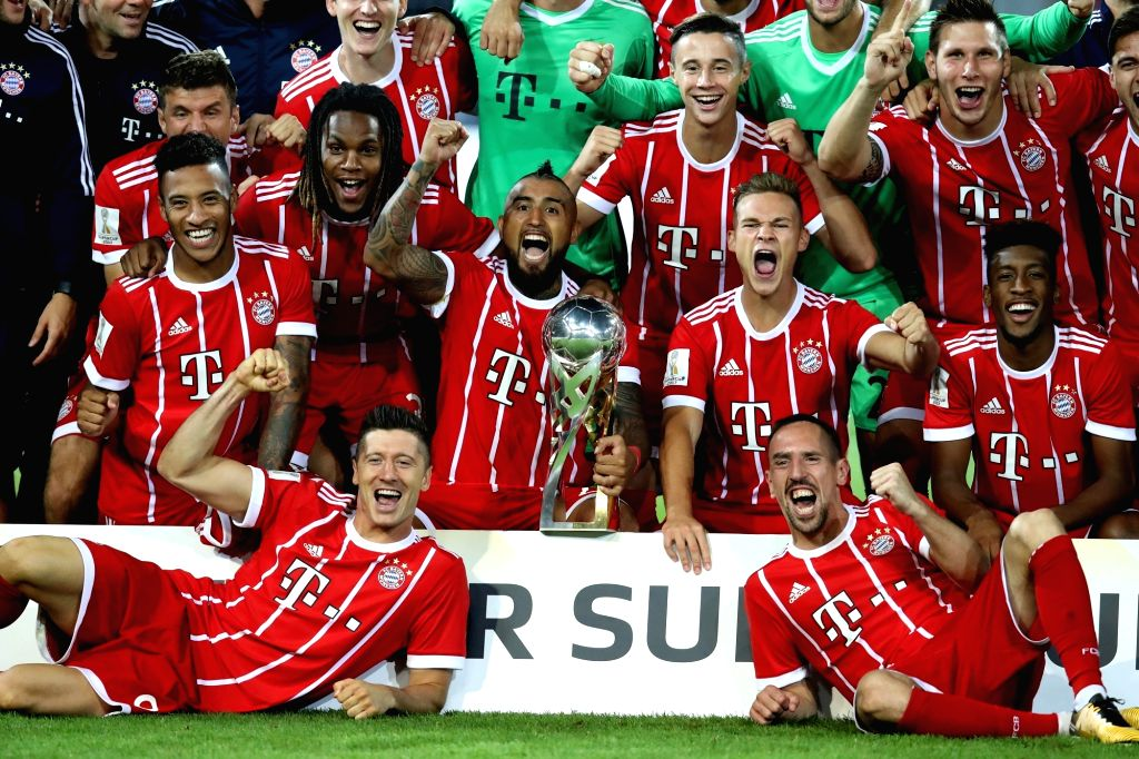 DORTMUND, Aug. 6, 2017 - Players of Bayern Munich pose for photos with the German Super Cup trophy during an awarding ceremony after the 2017 German Super Cup match between Bayern Munich and Borussia ...