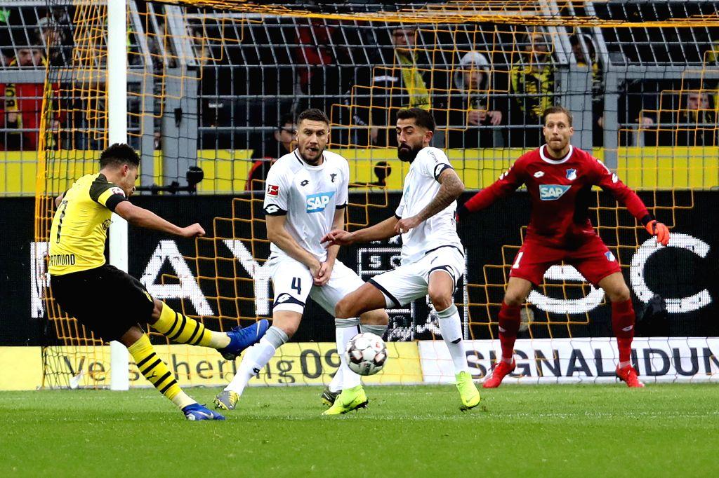 DORTMUND, Feb. 10, 2019 - Jadon Sancho (1st L) of Dortmund shoots during the Bundesliga match between Borussia Dortmund and TSG 1899 Hoffenheim in Dortmund, Germany, Feb. 9, 2019. The match ended in ...