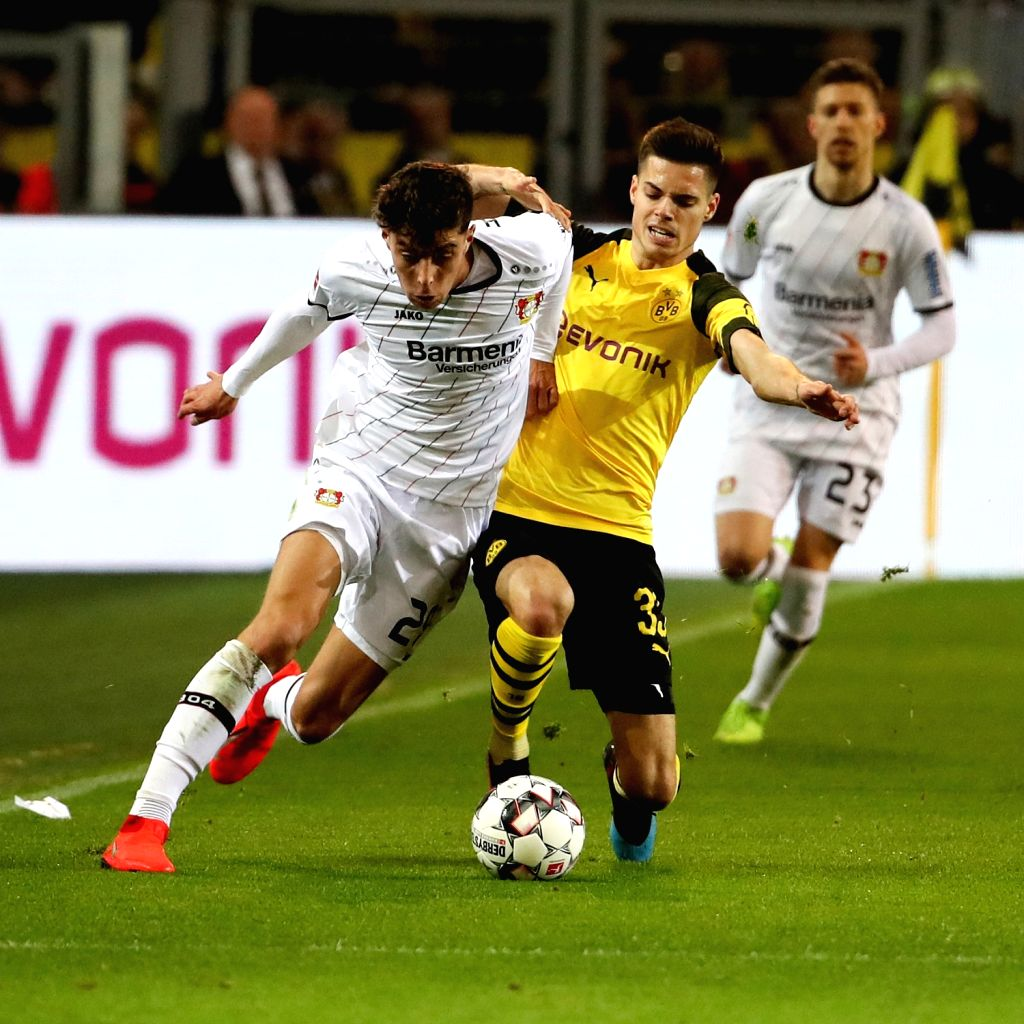 DORTMUND, Feb. 25, 2019 - Paco Alcacer (C) of Dortmund vies with Charles Aranguiz (L) and Jonathan Tah of Leverkusen during the Bundesliga match between Borussia Dortmund and Bayer 04 Leverkusen in ...