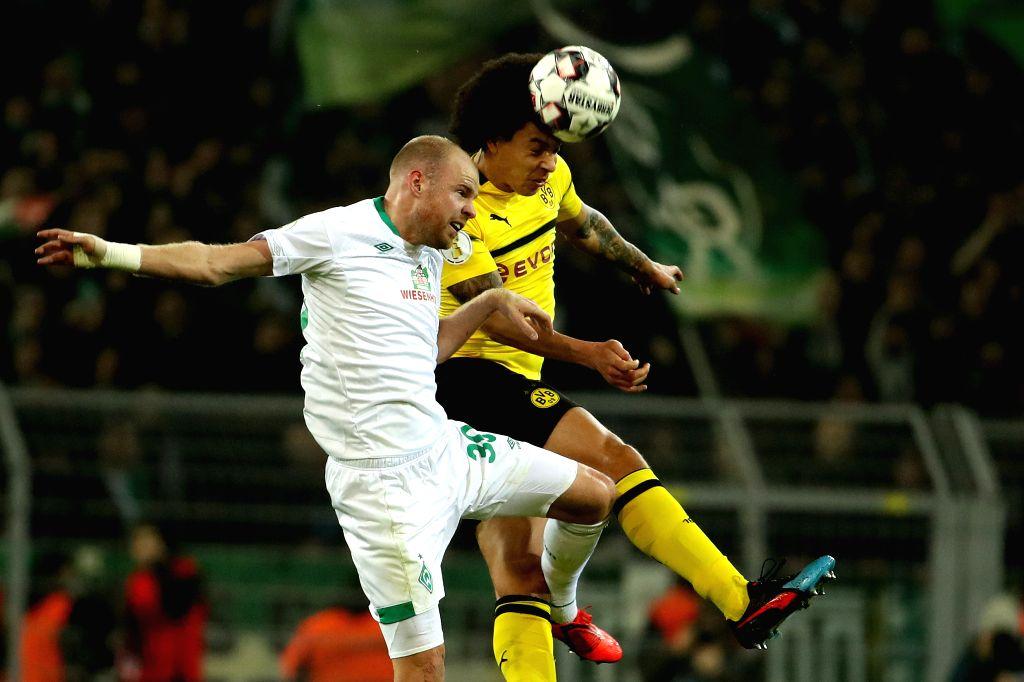 DORTMUND, Feb. 6, 2019 - Davy Klaassen (L) of Bremen vies for header with Axel Witsel of Dortmund during the DFB Cup third round match between Borussia Dortmund and SV Werder Bremen in Dortmund, ...