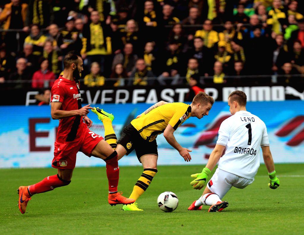 DORTMUND, March 5, 2017 - Marco Reus (C) of Borussia Dortmund fights for the ball during the Bundesliga match against Bayer 04 Leverkusen at Signal Iduna Park in Dortmund, Germany, March 4, 2017. ...