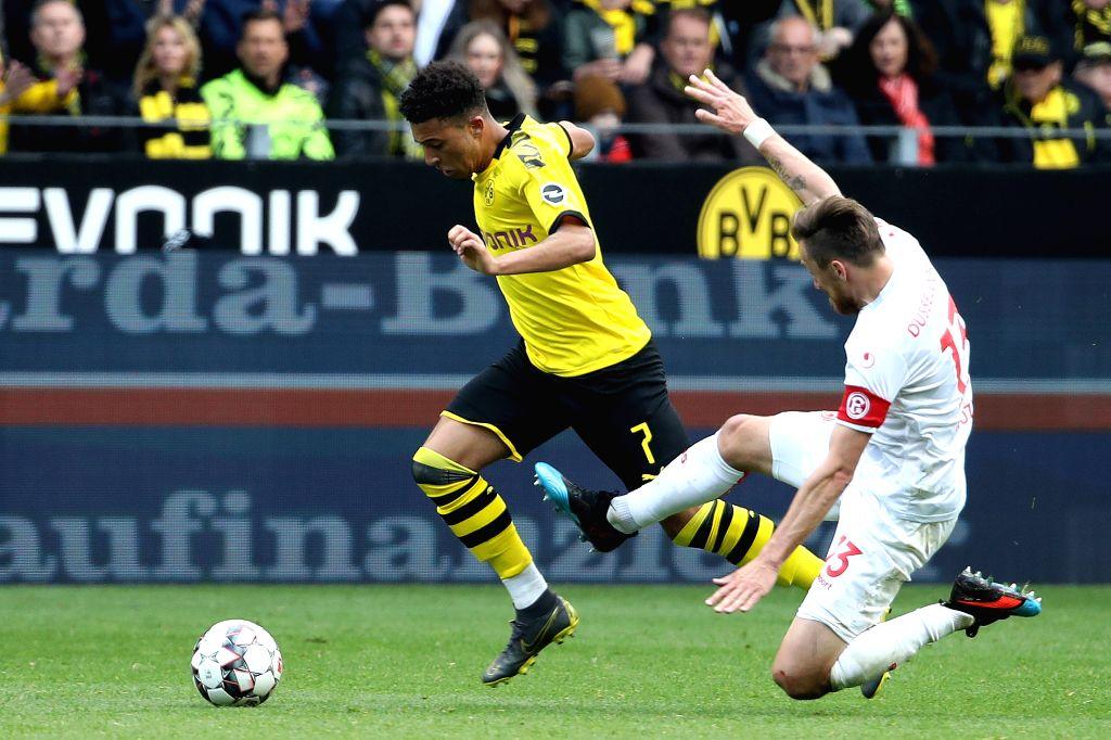 DORTMUND, May 12, 2019 - Adam Bodzek (R) of Dusseldorf vies with Jadon Sancho of Dortmund during the Bundesliga match between Borussia Dortmund and Fortuna Dusseldorf in Dortmund, Germany, May 11, ...
