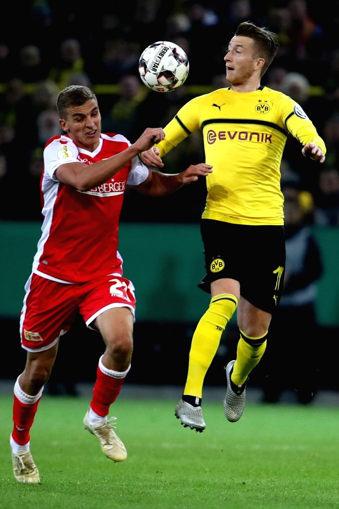 DORTMUND, Nov. 1, 2018 - Marco Reus (R) of Borussia Dortmund vies with Grischa Proemel of Union Berlin during the DFB Cup match between Borussia Dortmund and Union Berlin in Dortmund, Germany, Oct. ...