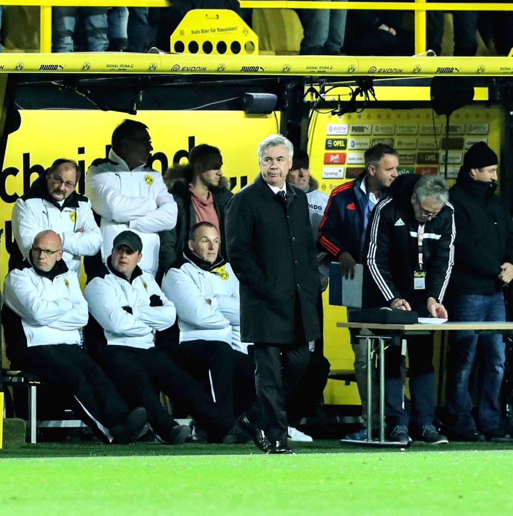 DORTMUND, Nov. 20, 2016 - Munich's coach Carlo Anchelotti (C) looks on during the German Bundesliga soccer match between Borussia Dortmund and Bayern Munich in Dortmund, Germany, Saturday, Nov. 19, ...
