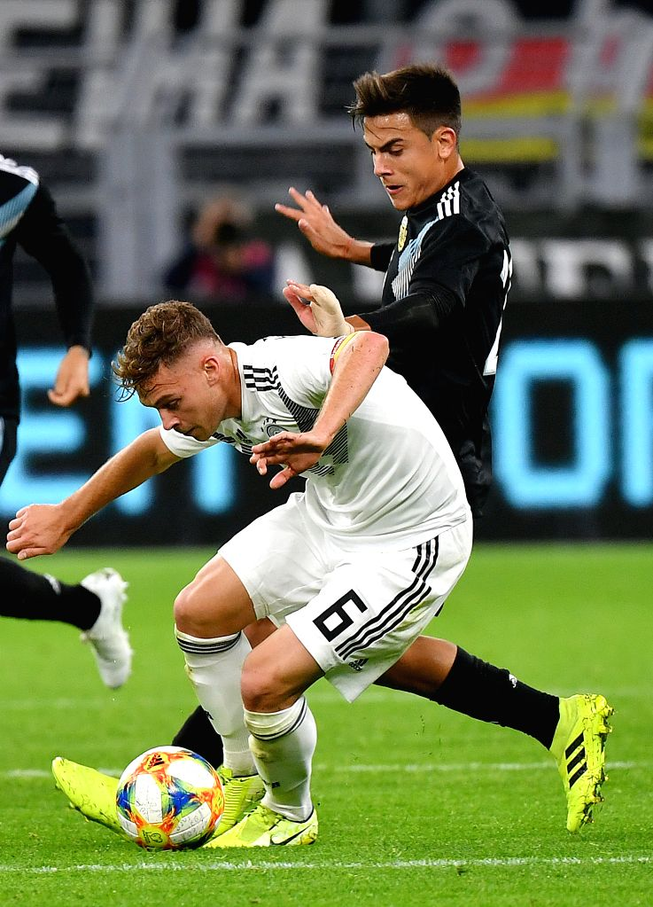 DORTMUND, Oct. 10, 2019 - Joshua Kimmich (front) of Germany vies with Paulo Dybala of Argentina during an international friendly soccer match between Germany and Argentina in Dortmund, Germany, Oct. ...
