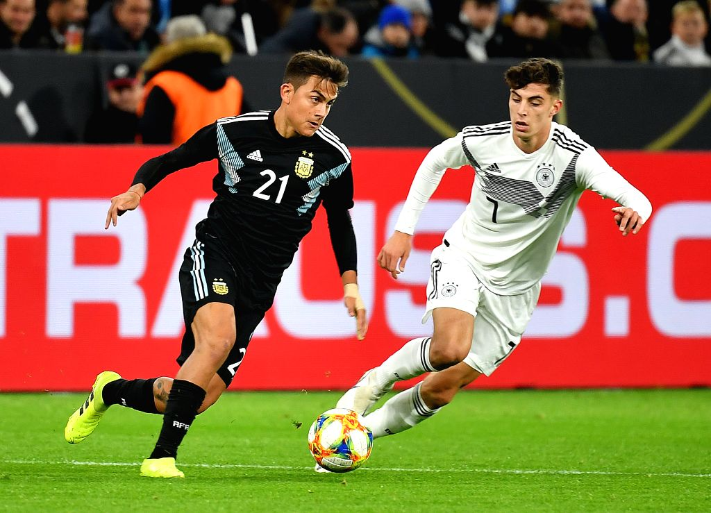 DORTMUND, Oct. 10, 2019 - Paulo Dybala (L) of Argentina vies with Kai Havertz of Germany during an international friendly soccer match between Germany and Argentina in Dortmund, Germany, Oct. 9, 2019.