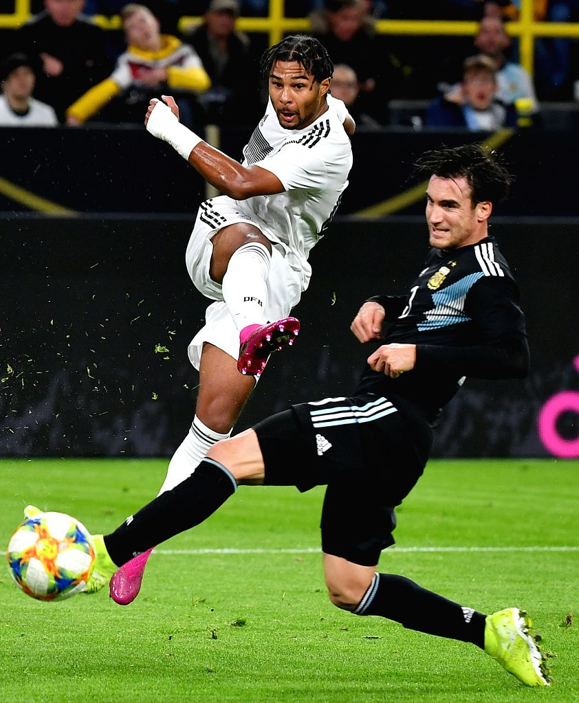 DORTMUND, Oct. 10, 2019 - Serge Gnabry (L) of Germany vies with Nicolas Tagliafico of Argentina during an international friendly soccer match between Germany and Argentina in Dortmund, Germany, Oct. ...
