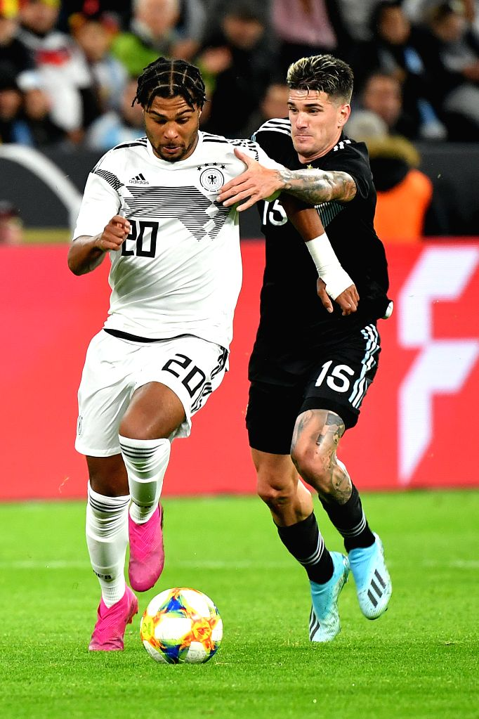 DORTMUND, Oct. 10, 2019 - Serge Gnabry (L) of Germany vies with Rodrigo de Paul of Argentina during an international friendly soccer match between Germany and Argentina in Dortmund, Germany, Oct. 9, ...