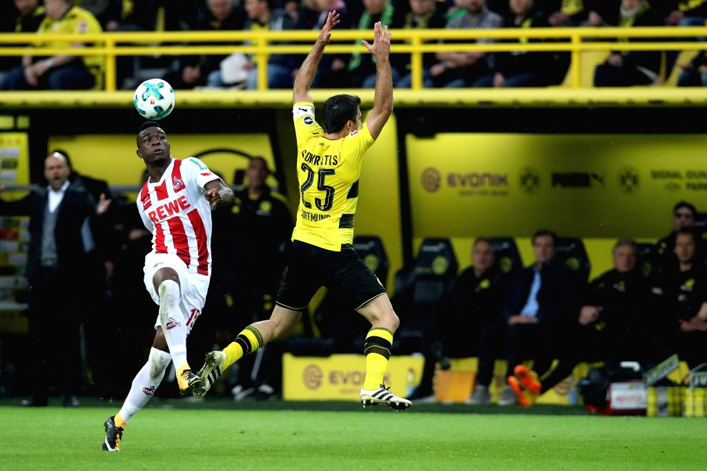 DORTMUND, Sept. 18, 2017 - Papastathopoulos Sokratis (R) of Borussia Dortmund and Jon Cordoba of 1.FC Cologne vie for the ball during the Bundesliga soccer match between Borussia Dortmund and 1.FC ...