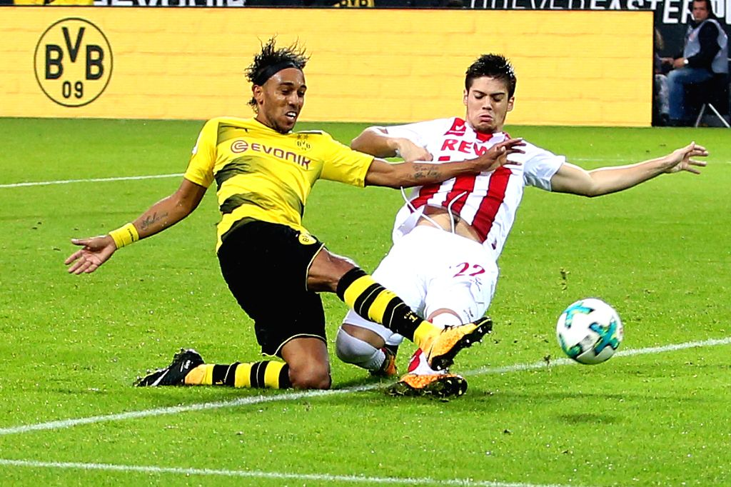 DORTMUND, Sept. 18, 2017 - Pierre-Emerick Aubameyang (R) of Borussia Dortmund and Jorge Mere of 1.FC Cologne vie for the ball during the Bundesliga soccer match between Borussia Dortmund and 1.FC ...