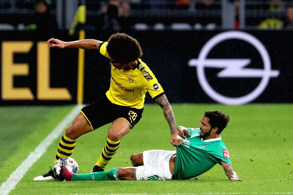 DORTMUND, Sept. 29, 2019 - Leonardo Bittencourt (R) of Bremen vies with Axel Witsel of Dortmund during a German Bundesliga soccer match between Borussia Dortmund and SV Werder Bremen in Dortmund, ...