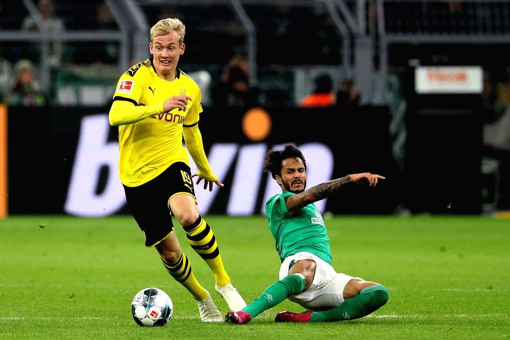 DORTMUND, Sept. 29, 2019 - Leonardo Bittencourt (R) of Bremen vies with Julian Brandt of Dortmund during a German Bundesliga soccer match between Borussia Dortmund and SV Werder Bremen in Dortmund, ...