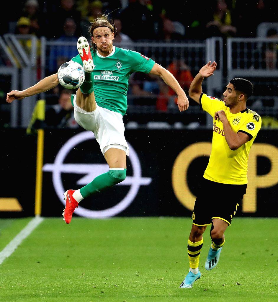 DORTMUND, Sept. 29, 2019 - Michael Rico Lang (L) of Bremen vies with Achraf Hakimi Mouh of Dortmund during a German Bundesliga soccer match between Borussia Dortmund and SV Werder Bremen in Dortmund, ...