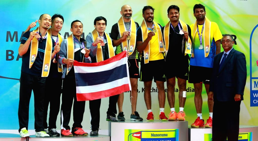 Doubles duo of Sanave Thomas, Rupesh Kumar and V. Diju, JBS Vidyadhar who won the gold and silver in the 35+ mixed doubles with their medals at the podium during World Senior Badminton ... - Rupesh Kumar