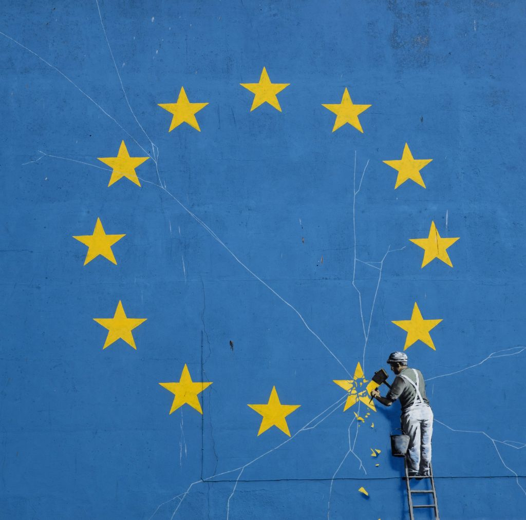 DOVER, Feb. 23, 2019 - Photo taken on Feb. 22, 2019 shows a painted mural by British graffiti artist Banksy, depicting a workman chipping away at one of the stars on a European Union (EU) themed flag ... - Banksy