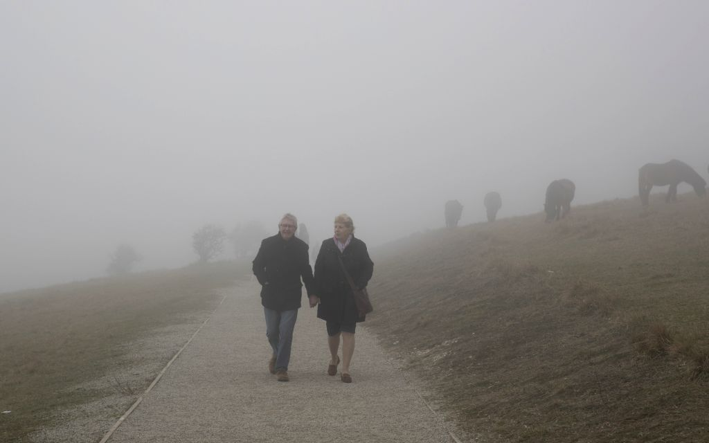 DOVER, Feb. 23, 2019 - Two pedestrians walk through thick fog in Dover, Britain, on Feb. 22, 2019.
