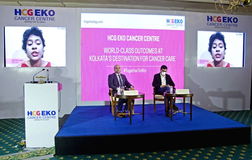 Dr. Joydeep Chakraborty and Dr. Virendra Kumar, COO HCG EKO Cancer Center interact with Cancer survivor Sathi Karmakar during a press conference, in Kolkata on Nov 25, 2020. - Joydeep Chakraborty and Virendra Kumar