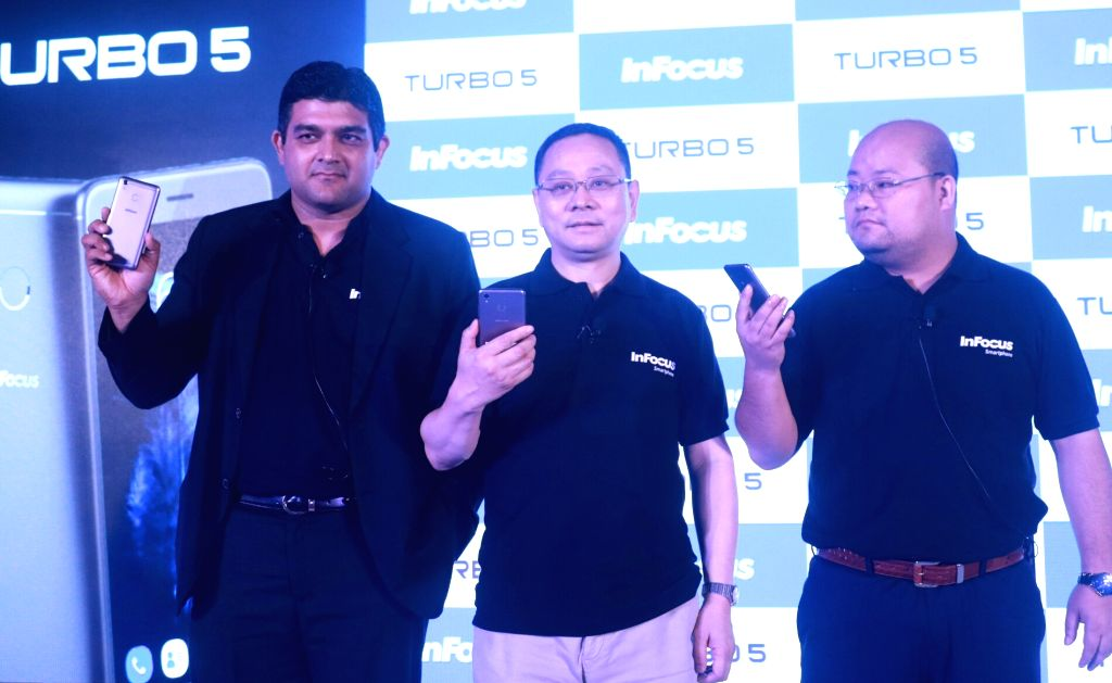 """Dr. Lou Zhongsheng and Piyush Puro of InFocus at the re-launch of smartphone """"Turbo 5"""" in New Delhi, on June 28, 2017."""