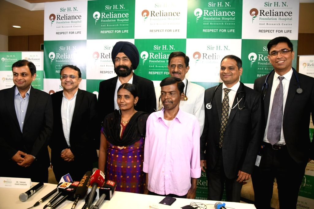Dr. Soumil Vyas, Dr. Pravin Agarwal, Dr A.S. Soin, Dr Chetan Bhatt, Dr Chetan Kalal, Dr Anil Singh with patient Santosh Bhendigiri and his wife Rupa Bhendigiri at a press conference in Mumbai. - Singh