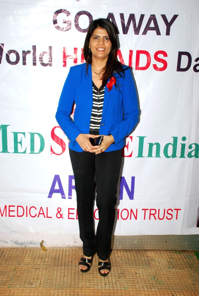 Dr.Sunita Dube for AIDS awareness while celebrating World AIDS Day in Mumbai on Dec 1, 2014.