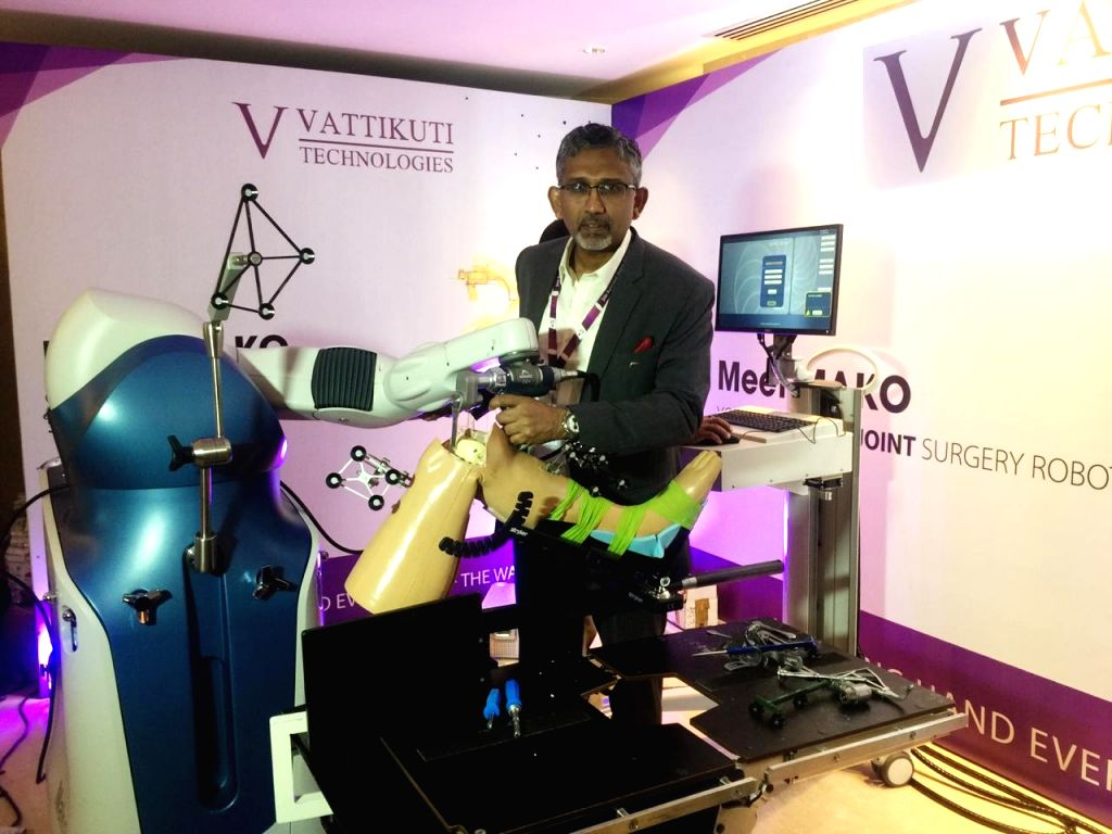 Dr Thadi Mohan from Amrita Institute of Medical Sciences, Kerala showcasing MAKO assisted Robotic total knee joint replacement surgery during a conference by Vattikuti Foundation on ...