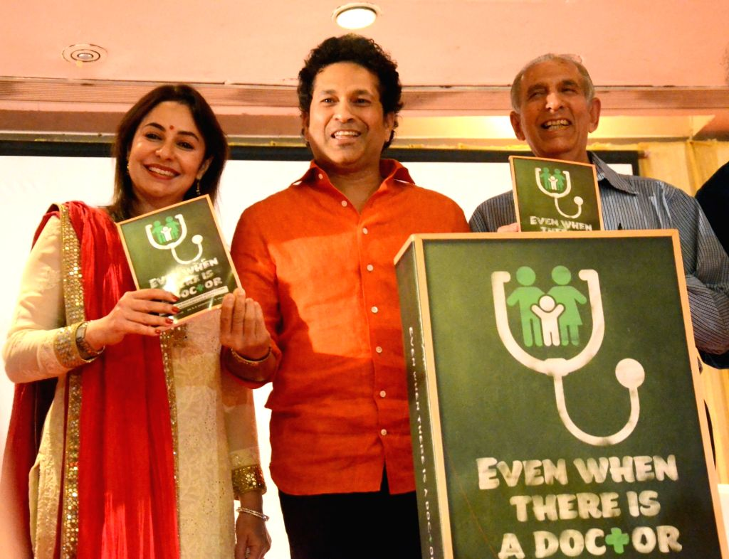 "Dr. Yashwant Ambdekar with Cricket legend Sachin Tendulkar and wife Anjali Tendulkar during the launch of his book ""Even when there is a Doctor"" in Mumbai on Feb 8, 2018. - Sachin Tendulkar"