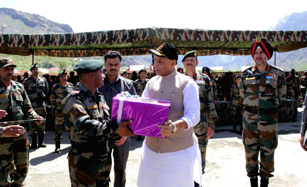 Dras: Defence Minister Rajnath Singh felicitates a trooper at the Kargil War Memorial in Dras of Jammu and Kashmir's Kargil district on July 20, 2019. (Photo: IANS/PIB) - Rajnath Singh