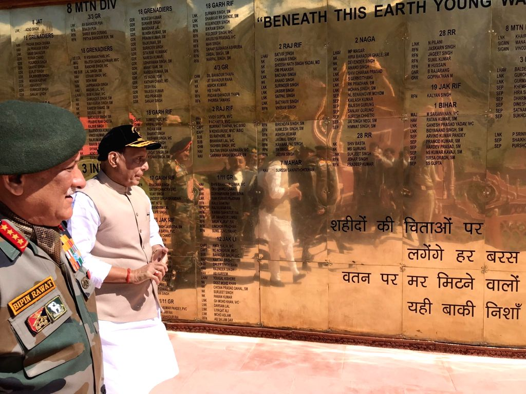 Dras: Defence Minister Rajnath Singh with Army Chief General Bipin Rawat during his visit to the Kargil War Memorial in Dras of Jammu and Kashmir's Kargil district, on July 20, 2019. (Photo: IANS) - Rajnath Singh