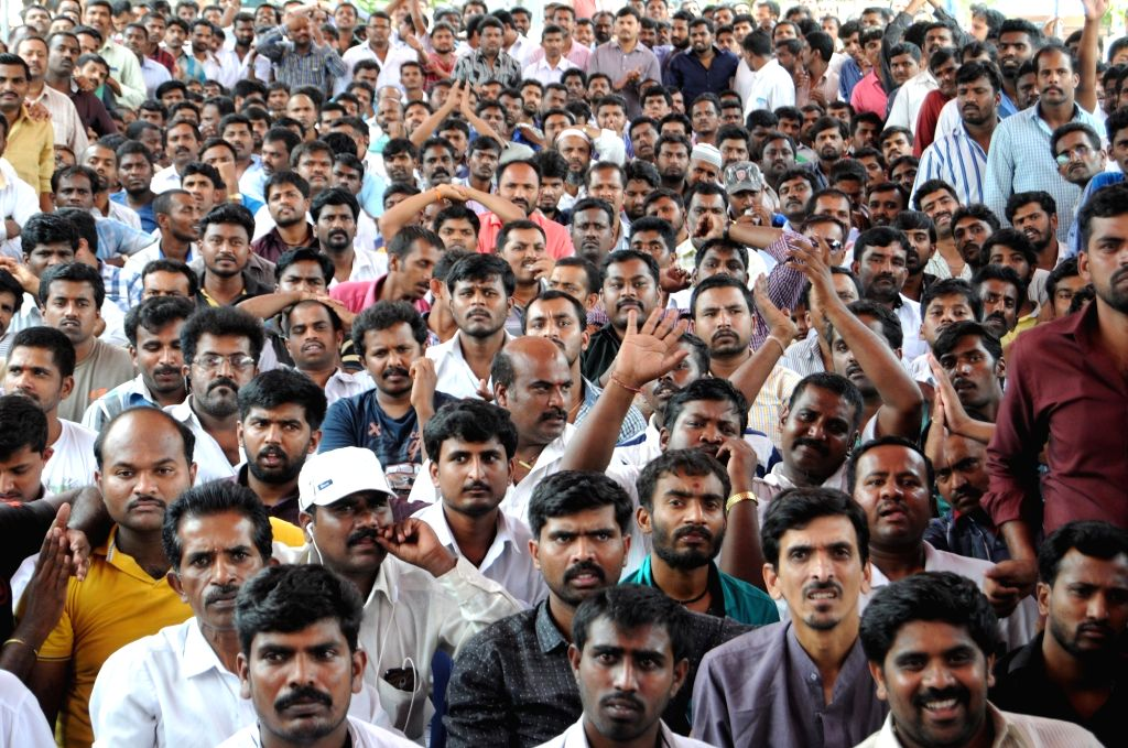Drivers of multi-national taxi services stage a demonstration against alleged harassment at RTO in Bengaluru, on May 31, 2016.