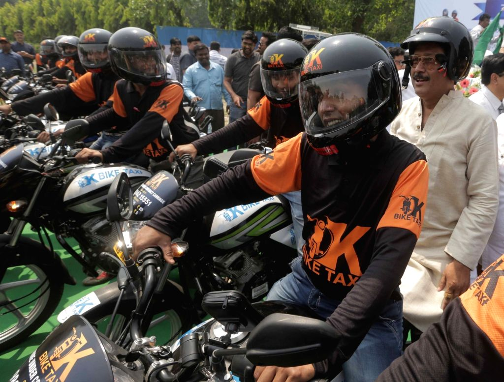 Drivers of One Man Taxi during the launch of Bike-taxi service in the New Town Kolkata Development Authority (NKDA) area; on March 16, 2017. The One Man Taxi will be available between 8 am ...