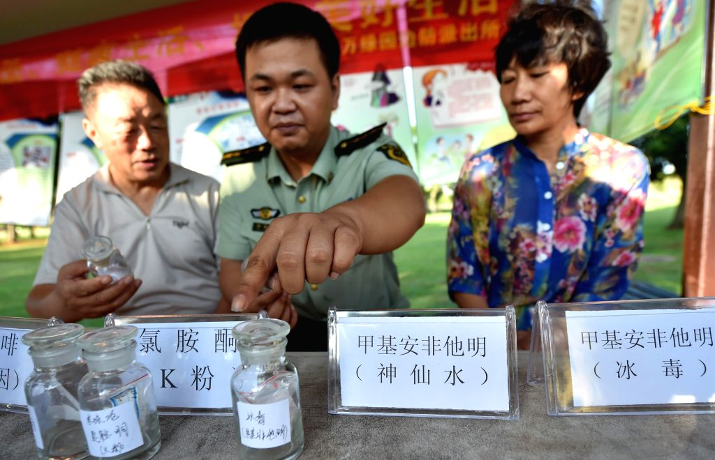 Drug samples are displayed during an anti-drug activity on the International Day Against Drug Abuse and Illicit Trafficking in Haikou, capital of south China's ...