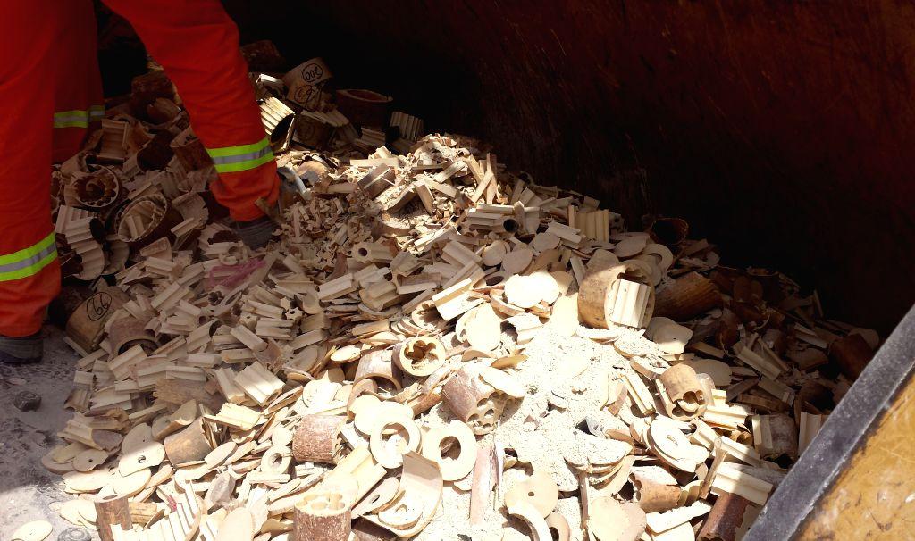 Photo taken on April 29, 2015 shows seized ivories after destruction in the Al Qusais district, Dubai, the United Arab Emirates. The United Arab Emirates (UAE) ...