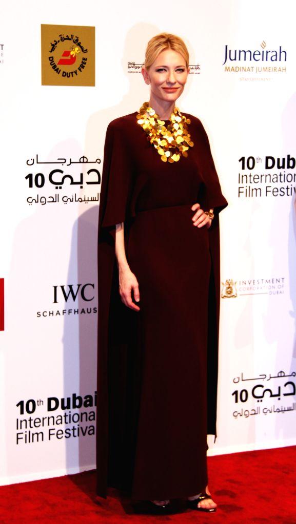 Australian actress Cate Blanchett poses for photos during the Dubai International Film Festival in Dubai, the United Arab Emirates, Dec. 6, 2013. The 10th Dubai .. - Cate Blanchett