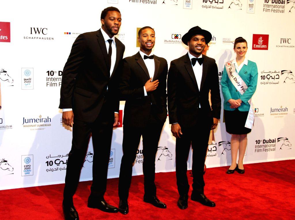 "Cast members of American film ""Fruitvale Station"" pose for photos during the Dubai International Film Festival in Dubai, the United Arab Emirates, Dec. ."