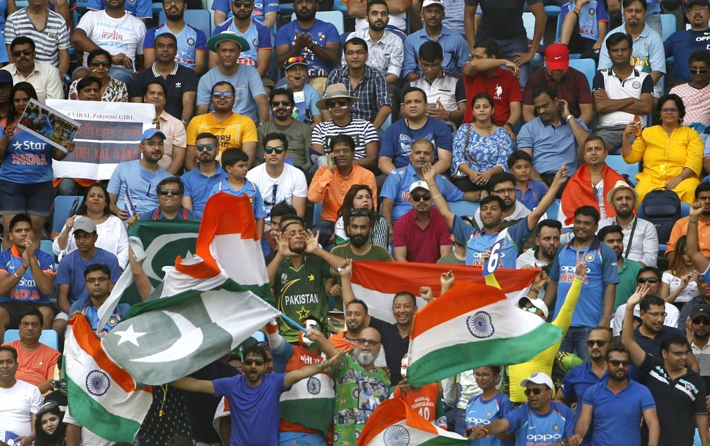 Dubai: Fans of India and Pakistan cheer for their respective teams during the third match of Asia Cup 2018 Super Four between India and Pakistan at Dubai International Cricket Stadium in Dubai, UAE on Sept 23, 2018. (Photo: Surjeet Yadav/IANS) - Surjeet Yadav
