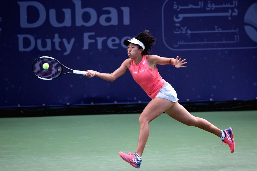 DUBAI, Feb. 18, 2019 - Zhang Shuai of China hits a return during the women's singles first round match against Anett Kontaveit of Estonia at Dubai Duty Free Tennis WTA Championships 2019 in Dubai, ...